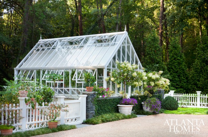 The sizable lot backs up to a 100-acre nature preserve, a treat for the homeowners, who are avid gardeners and enjoy being outdoors. Together with Michaelides, they dreamed up a fantastical backyard, which included this greenhouse designed by Baker.