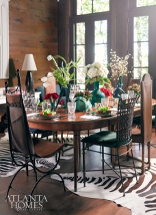 Designer John Oetgen and creative John Lineweaver enjoy entertaining at their Highlands, North Carolina abode. In their dining room, Oetgen fashioned a Christmas jungle in which the refined and the ordinary, simple and pretentious deftly mix.