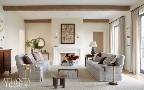 """With oversize Hickory sofas to match the room's long proportions, the formal living room was designed for entertaining. However, Howard was mindful to keep fabrics and other elements practical. """"With kids, everything is fair game. I didn't want to put in anything that was uncomfortable to sit in or off-limits,"""" he says. The artwork above the mantel is from Mrs. Howard, his family's interior furnishings shop with locations in both Jacksonville and Atlanta."""