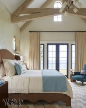 Soft colors and river views create a sense of serenity in the master bedroom.