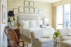 """The master bedroom retains much of Dan Carithers' original touch, particularly in the upholstered walls, which buffer sound between this residence and the neighbors'. """"My favorite change to this room was switching out a tall, dark antique linen press—because TVs don't need to go in armoires anymore—and replacing it with a beautiful, leather-wrapped console from Thomas O'Brien,"""" Kirkland says."""
