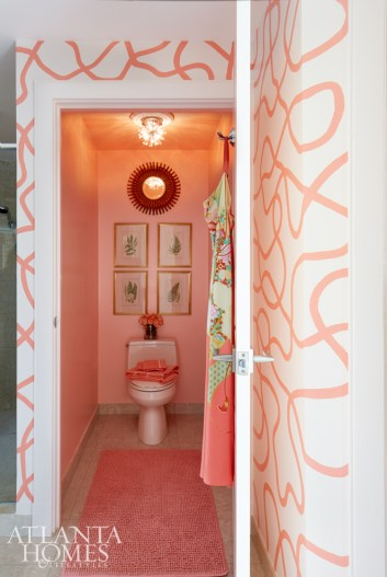 """Kirkland calls the original abstract pattern artist Brian Carter created for the master bathroom a kind of """"noodling"""" effect. The couple loves the motif's uniqueness—and that they won't have to worry about heat and moisture damage, as they might with a traditional wallcovering."""