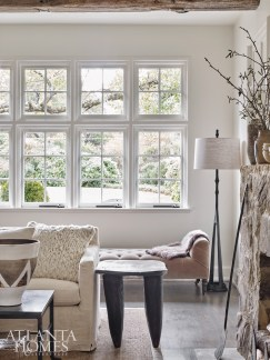 Because the house sits back from the street, and privacy was not a concern, the Weitzes opted to keep the windows bare, for a more European feel.