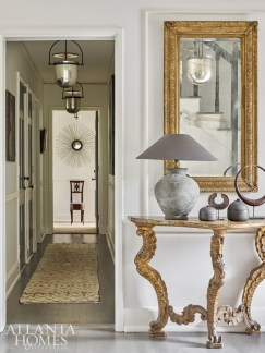 The entry foyer and hallway strike a lustrous, elegant note.