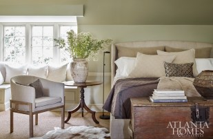 "After a busy day on the showroom floor surrounded by plenty of pattern and color, the Weitzes' main wish was to come home to ""something serene,"" says Debbie of the master bedroom. Pillows, jars and throws, through B. D. Jeffries."