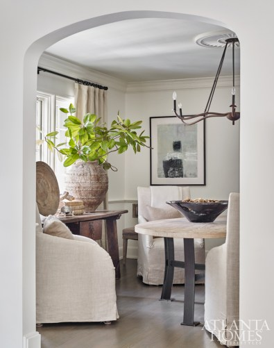 A recent renovation removed a wall between the dining and living rooms; the resulting archway reveals an intimate space where large-scale pieces make the room feel bigger than it is.