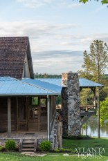 A cantilevered porch takes advantage of both a sloping lot and panoramic views of the property's lake.