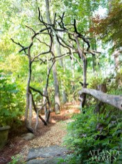 """A rustic arbor made of """"squiggly"""" mountain laurel wood and reinforced with local locust wood."""