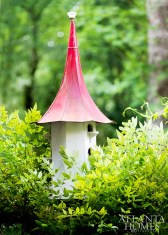 North Georgia artisan Tim Crane hand-crafted the quirky bird house, whose roof is fashioned from a repurposed victrola.