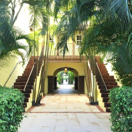 The hotel's lush landscaping matches its tropical setting.