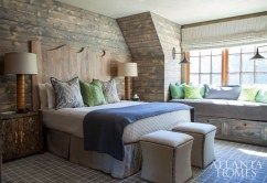 For a guest bedroom, King chose a muted gray wash for the wood walls, giving the room a seamless look along with the other soft shades of blue and green.