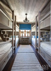 """""""One of the client's requests was room to sleep a lot of people, so built-in bunk beds were a natural choice for one of the five bedrooms,"""" says Busch."""