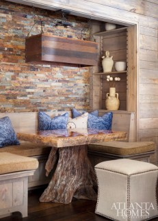 The table in the sitting nook, made by furniture maker Brad King, was designed to be a conversation piece with its unique base.