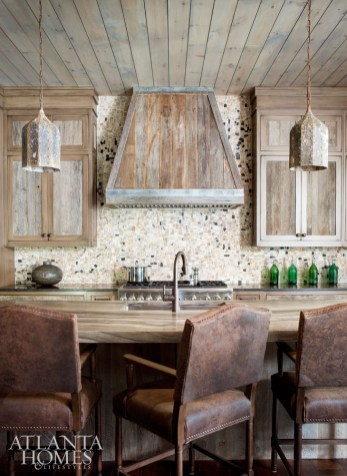 """The use of reclaimed wood continues in the kitchen with the cabinet fronts. """"It's a marriage of old and new,"""" says Beni Borza of Kingdom Woodworks."""