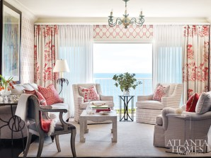 The lattice-inspired Nina Campbell wallpaper offers an updated retro effect and, as designer Carole Weaks notes, interacts beautifully with the overscaled Pam Heavner drapery print in the same shade. Beneath these, a layer of billowy sheers frames a breezy path to the porch.