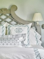 Crisp monogrammed bed linens from The Linen Ladies share a calming shade of blue with the rest of the master bedroom.