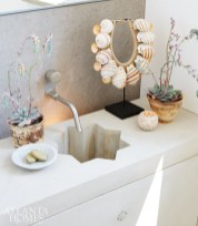 Like the rest of the property, the powder room sink offers a twist on the traditional, with its star-detailed bowl that Mayers designed to add panache to the stone vanity.