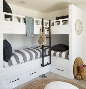 The bunk room, which sleeps four, is shipshape thanks to its white siding and coastal-inspired linens from Interior Philosophy.