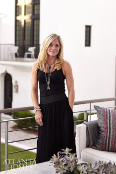 Mandy Mayers, co-owner of Interior Philosophy, stands on the second story of her Alys Beach home.