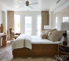 In the upstairs bedroom, Mayers didn't want bright colors to take away from the serene palette. She chose an assortment of oatmeal tones, adding fun elements such as fur-trimmed pillows and an antique lumbar pillow with hints of color.
