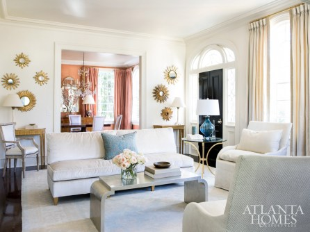 The cream and champagne hues that grace the living room allow bolder splashes of color in adjacent rooms to shine. Pair of consoles, Parc Monceau. Armless sofa, Hickory Chair, upholstered in Donghia. Lounge chair, Saladino, upholstered in Nancy Corzine. Drapery fabric, Holland & Sherry, with Samuel & Sons trim. Side table, Jan Showers through Ainsworth-Noah.