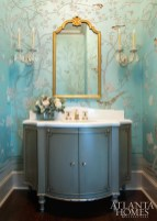 The exquisite custom de Gournay paper in the ground floor powder room pulls in hues from other rooms in the house. Vanity through Renaissance Tile & Bath. De Gournay through Ainsworth-Noah.