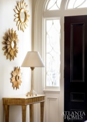 In the living room, a trio of sunburst mirrors from English Accents reflect the outdoor light.
