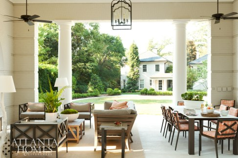 Practical but stylish outdoor furniture from Janus et Cie provides a comfortably chic space for the homeowners to both relax and entertain, even in colder months. Landscape architect Richard Anderson created a lush backdrop between the main house and pavilion.