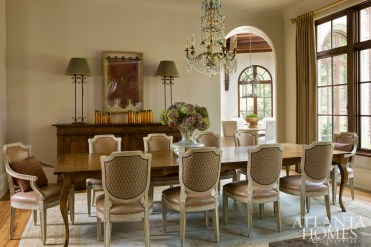 As frequent entertainers, the homeowners sought a dining area that was beautiful and durable. The table and chairs, both crafted by Dennis & Leen, embody an understated elegance that is fit for formal dinners as well as casual family lunches. The seating is covered in easy-to-clean Cortina leather and backed with a patterned Fortuny fabric.