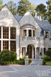 Measuring at a sizable 14,000 square feet, this palatial Kennesaw home, which favors the style of an English countryside estate, has five bedrooms and seven baths.