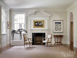 """""""A pedimented overdoor and overmantel were used in the living room and were inspired by Reid's original design."""" says Dixon."""