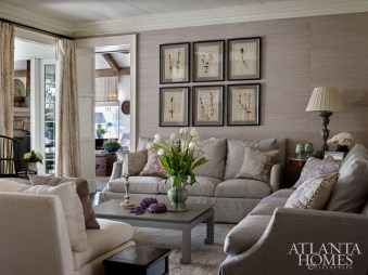 "Lanham covered the living room walls in a pale lavender grass cloth from Schumacher. The antique pressed botanicals were ones that the designer had ""hoarded for many years,"" she laughs. ""I could only let them go to someone who would love them as much as I do, and I knew this homeowner would."""