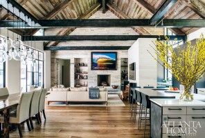 Patrick envisioned an open floor plan with a mix of industrial details, like exposed metal beams and steel windows, and warm materials, including five varieties of woods from the floor to the ceiling.