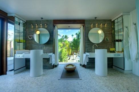 Parisian designer Giles LeBourgne designed these stunning bathrooms.