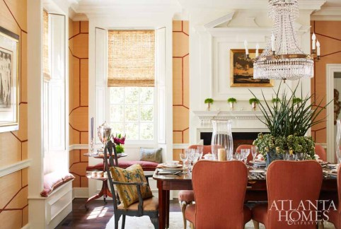 """While few families """"live"""" in the front of the house anymore, says architect Yong Pak, keeping the home's historic core intact was a priority. Elements such as the heart pine floors were reclaimed from an Athens, Georgia, home when they were originally installed for the Haverty's. The raised paneling on the mantel, over-mantel and the door surrounds retain the integrity of the original home."""