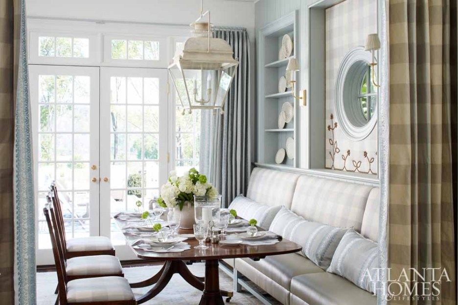 Dining area with pale blue walls, white lantern, banquette seat, dining table, Hepplewhite chairs