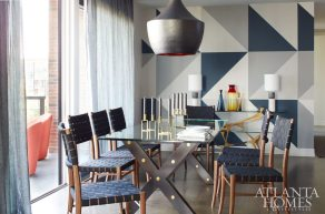 Khandwala and artist Todd Seay conceptualized a blue-and-gray color-blocked wall in the dining room. A hand-hammered copper chandelier from Peachtree Battle Antiques hangs above a Restoration Hardware dining table.