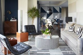 To accommodate a pair of clients who split their time between Atlanta and New York, designer Aamir Khandwala outfitted this Midtown condominium with modern elements, bold patterns and shades of blue for a masculine retreat that's as welcoming as it is streamlined.