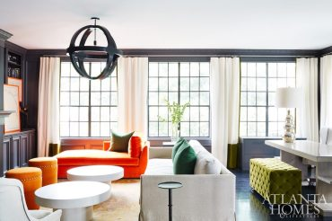 Color is king in the study, where dramatic walls—painted Benjamin Moore's Iron Mountain in a semigloss finish—set the moody-meets-elegant tone. The drama doesn't stop there, as saturated green pillows and burnt-orange chaise longues maximize the color-forward space.