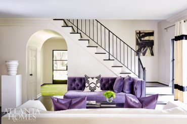 Neutral walls (Seapearl by Benjamin Moore), and vibrantly hued furnishings, such as a plush purple arm chaise and matching slate-colored chaises (all from South of Market), add a cheerful disposition to the main-level living spaces.