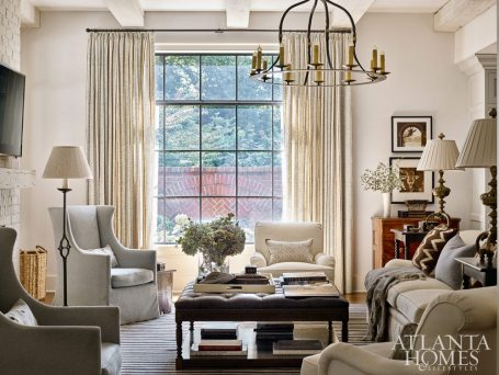 """The Dessin Fournir wing chair is one of designer Liza Bryan's favorite touches. """"It gives you the height you need by the fireplace without looking like Grandma's chair,"""" she says."""