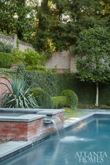 Cradled by a Boston ivy-clad brick wall, the pool surround strikes a balance between the simple and the formal. Thanks to valiant efforts by Duffey, Childers and landscape architect Alex Smith to alter the rear courtyard and hardscapes (including the addition of an octagonal porch), the pool and outdoor living spaces now relate to both each other and the house naturally and seamlessly.