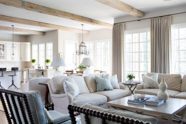 The light-filled family room and dining alcove's large windows flood the spaces with natural light.