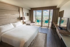 The rooms at the Hilton at Resorts World Bimini offer luxurious amenities and breathtaking views of Bimini's bright blue water.