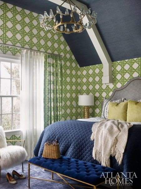Bright-green lattice wallpaper by Carleton V Ltd., paired with a navy Phillip Jeffries grass cloth ceiling, brings playful drama to the master bedroom. A large-scale parakeet on canvas by Southern artist Jason Horton adds an eclectic touch to the nest.