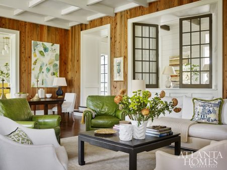 He achieved an inviting atmosphere when designing the entryway by using interior windows made to look antique. They peer into the sunken living room, which was also designed to emulate the coziness of an older residence. Interior designer Heather Dewberry fashioned a unique mix of the traditional and the whimsical with striking results.