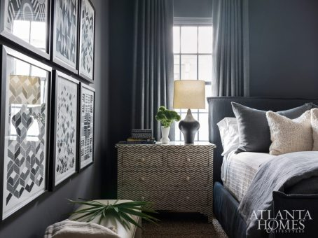 This guest bedroom, designed with the Plumbs' sons in mind, is painted a masculine charcoal gray (Restoration Hardware's Charcoal). The bed linens are through Traditions Linens.