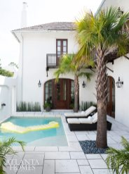 Punctuated by palm trees, this intimate outdoor patio and pool offer just the right amount of comfortable, casual, space for soaking up the sunshine.