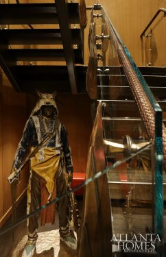The suite's luxe sensibilities extend to the glass, iron and leather staircase, which becomes a stunning backdrop for art such as the Native American sculpture by Dave McGary brought in from Blank's Montana ranch.