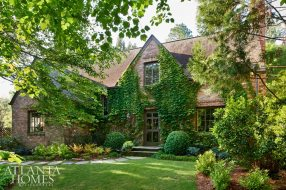 """Natural Escape Located in the heart of Buckhead, the Tudor cottage is nestled into a verdant setting. """"The gardens go on and on and have the feel of a secluded sanctuary,"""" says homeowner Mary Kate Hewes."""